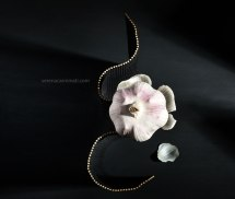 Creative still life on dark bakground with garlic and garlic skin on black table mat.