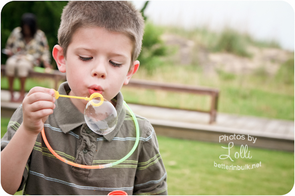 6 year old boy blowing bubbles