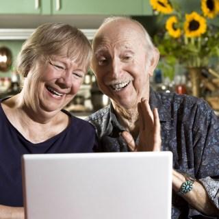 Grandparents using skype to talk with Grandchildren