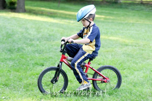 young boy on a bike