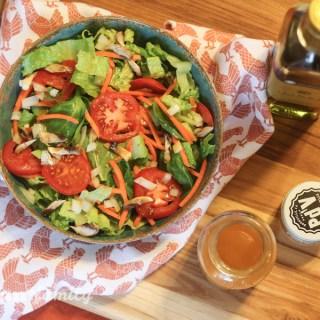 Homemade French dressing with piment d'ville espelette pepper on a fresh garden salad