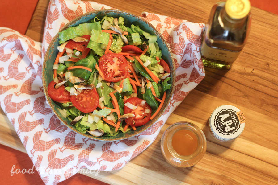 Homemade French dressing with piment d'ville espelette pepper on a fresh garden salad