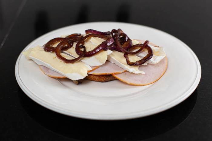 toasted sourdough bread with fig preserves, turkey bread, brie and balsamic caramelized onions