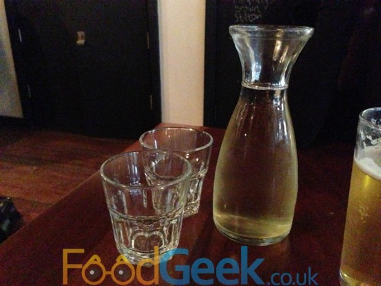 Carafe Of House Wine With School Glasses
