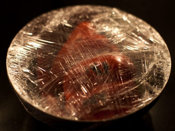 Wrapping the bowl in cling film helps the skin to loose because of the moisture formed inside the bowl.