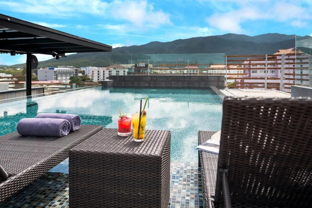 stunning rooftop infinity pool, which overlooks the city. Check it out: The Akyra Manor is a stylish luxury boutique hotel located in Chiang Mai, Thailand. I love the concept of the property- each suite is created around a courtyard within a room concept, which means, immediately upon entering the room, I was a view that you'll have to see for yourself.