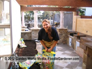 Shirley in her outdoor kitchen and vegetable garden