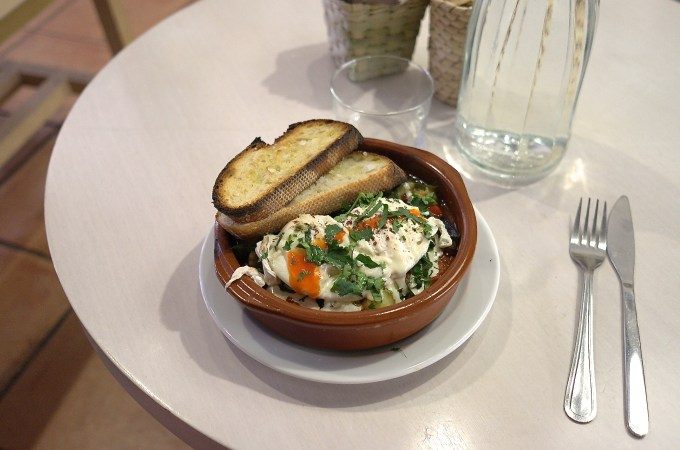 Poached eggs with eggplant, potatoes and lots of herbs