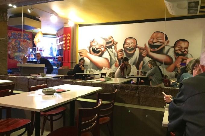 Mural of laughing men at Nanit restaurant