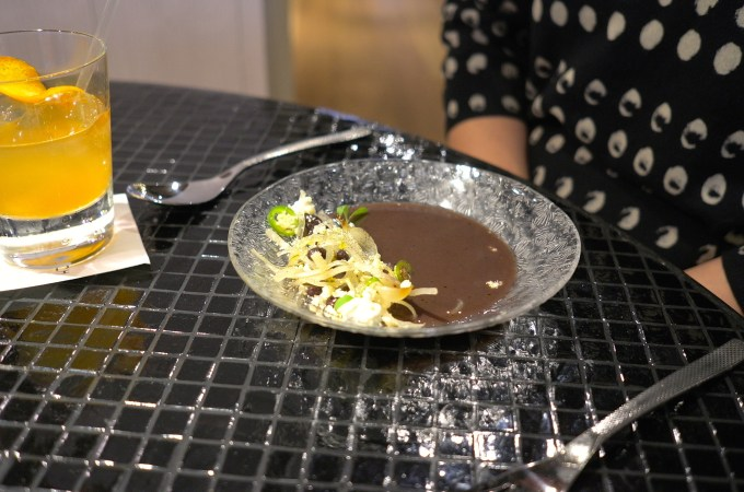 Black bean broth with cauliflower and pickles at Hoja Santa