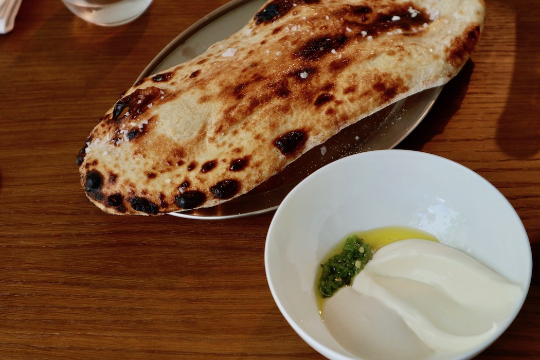 Focaccia served with tahini, yogurt and green chilli paste at Mr. Porter restaurant