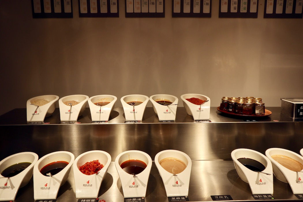 Different sauces from which you can make your own dipping sauce at Chiongqing Liuyishou Hotpot