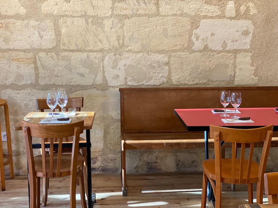 Wooden tables and chairs at Soif Bordeaux