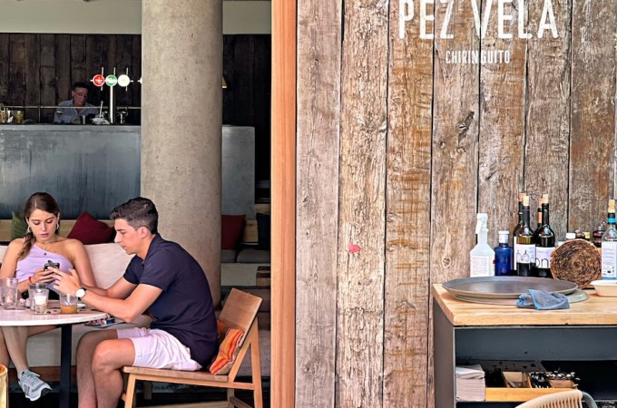 A couple eating at Pez Vela