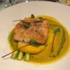 Arctic Char in Tumeric Seasoned Broth on Asparagus with Micro Beet Green Garnish
