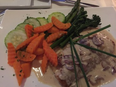 Fish in mushroom sauce with veggies