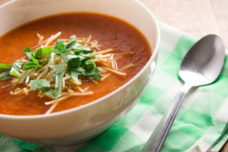 An easy, low-calorie, vegan, and delicious tomato soup recipe perfect for weeknight dinners. Only 85 calories per cup!
