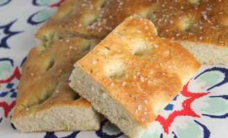 Soft and fluffy focaccia bread with rosemary and sea salt. It's so easy - perfect for a novice baker.
