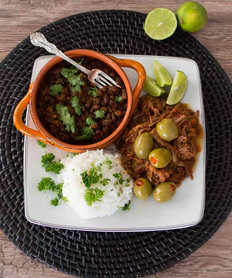 Ropa Vieja, a Cuban dish of beef stewed in a peppery tomato broth, reaches tender perfection in the slow cooker.