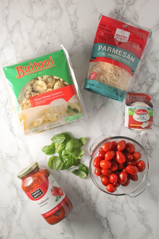 Baked Caprese Tortellini - you're only 6 ingredients and 30 minutes away from your new favorite pasta recipe.