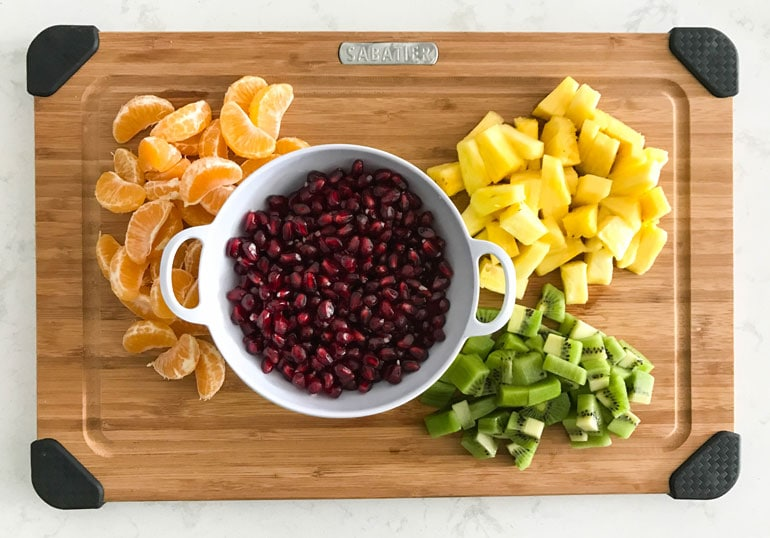 The bright, fresh flavors of this winter fruit salad include citrus, pineapple, pomegranate, kiwi and apples. A simple honey-lemon dressing brings everything together.