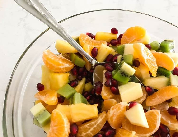 Seasonal citrus, pomegranates and pineapple team up with apples and kiwi in this gorgeous fruit salad.