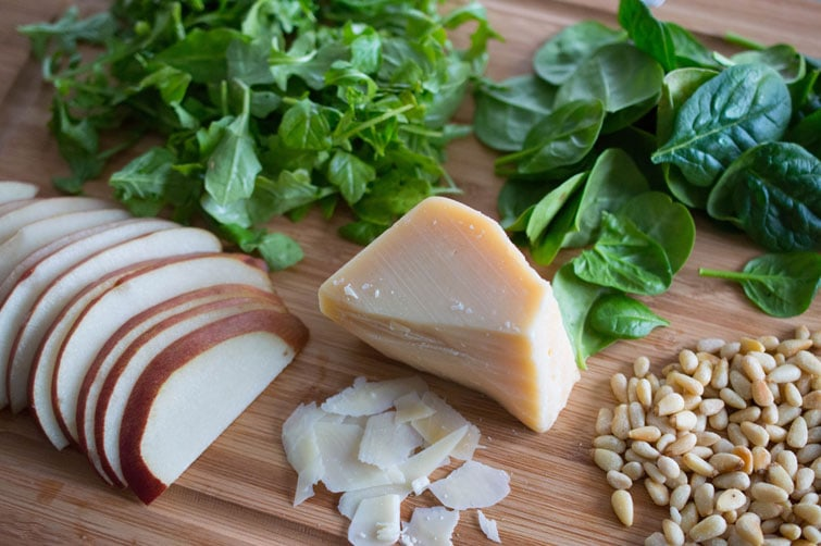 Beautiful fresh ingredients for Italian salad with pears, shaved Parmesan and honey-balsamic vinaigrette