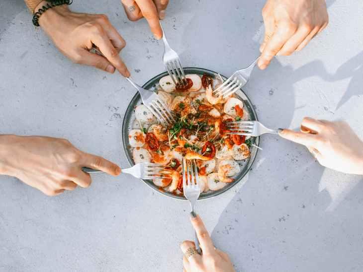 people sharing seafood