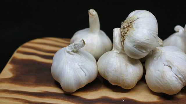 garlic bulbs on brown surface