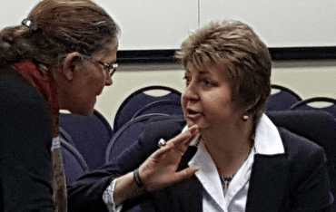Advocate Joan Adams, right, discusses a point with Dr Janet Giddy.