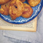 Homemade Eccles Cakes on a Floral Blue Plate with Vintage Book and Blue Linen Napkin