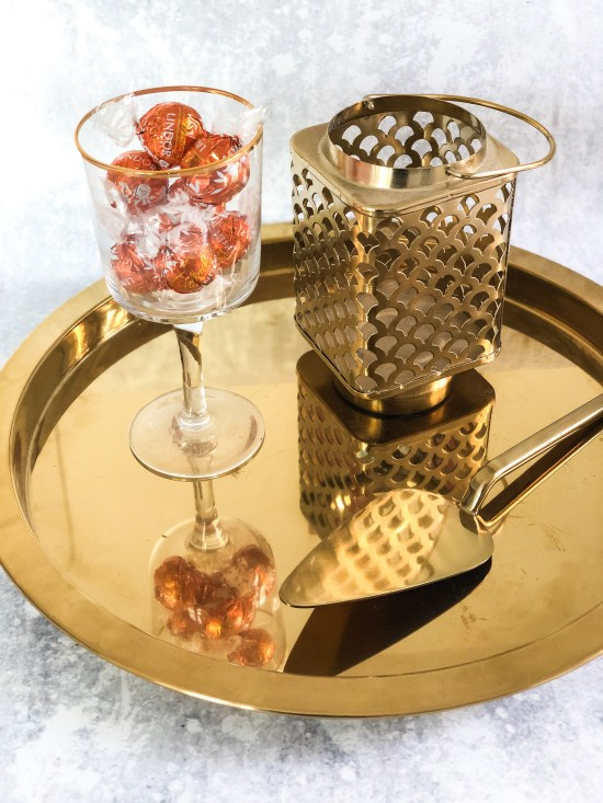 Golden Platter with Glass Full of Orange Lindt Chocolate Truffles