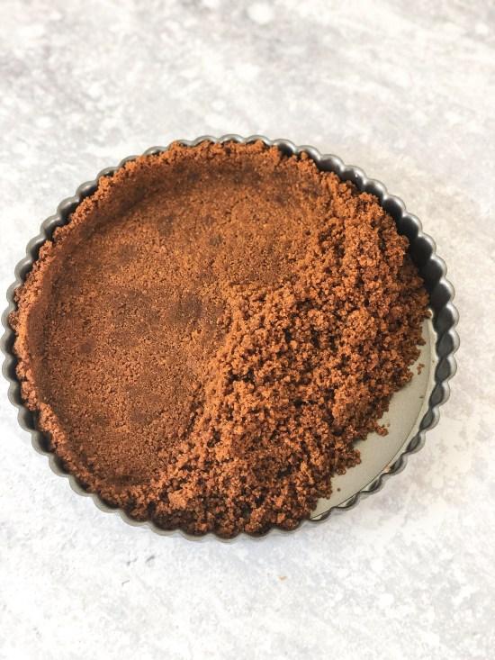 Pressing Speculoos Biscuit Crumbs for Pumpkin Pie