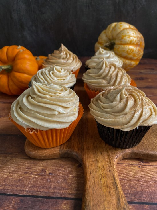 Spiced Pumpkin Cupcakes with Cinnamon Cream Cheese Frosting Recipe on Wooden Board - www.foodnerd4life.com