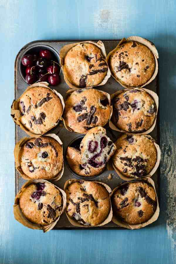 Fresh baked cherry muffins loaded with chunks of dark bittersweet chocolate. These are the perfect way to start your day along with some hot coffee!