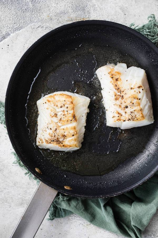 cod searing in a pan