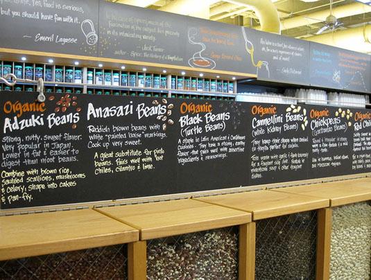 Informative displays topping bulk legume bins at Whole Foods Market Lamar, Austin, Texas