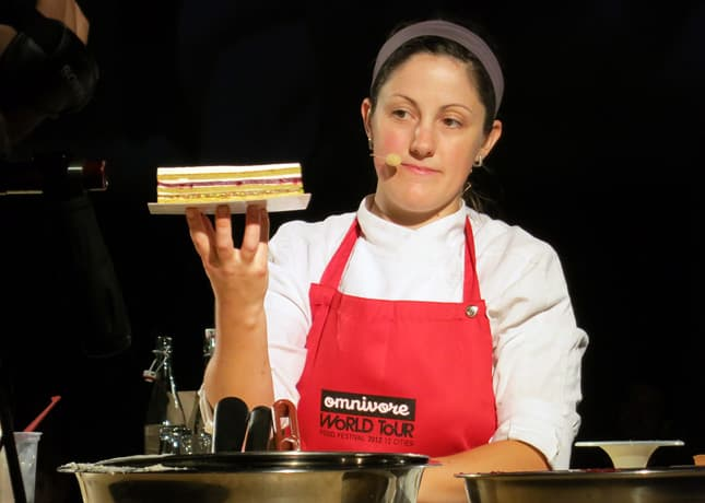 Pastry chef Stéphanie Labelle showing off her picture-perfect layered cake at the Omnivore Food Festival, Montreal / FoodNouveau.com