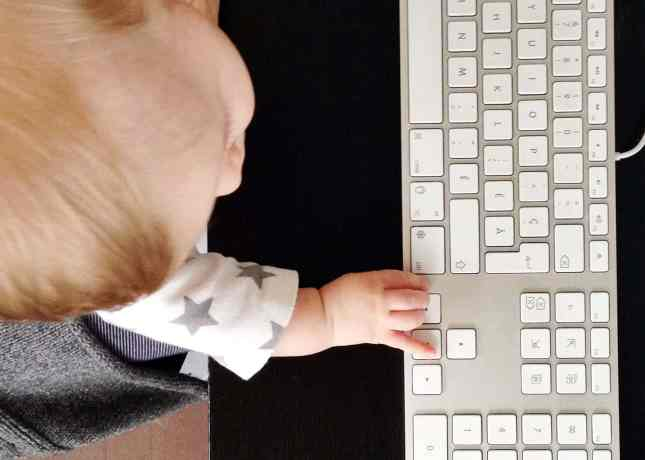 Baby J with hand on keyboard // FoodNouveau.com