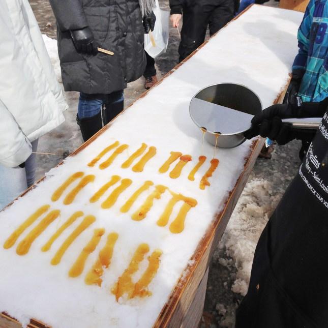 Serving maple taffy for a crowd, at Parc du Bois-de-Coulonge, Quebec City // FoodNouveau.com