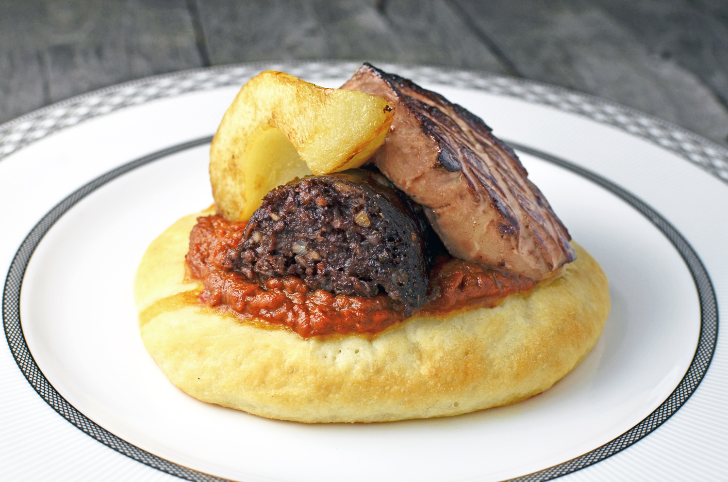 Hungarian Goulash, Blood Sausage, Foie Gras and Pear Tartlets