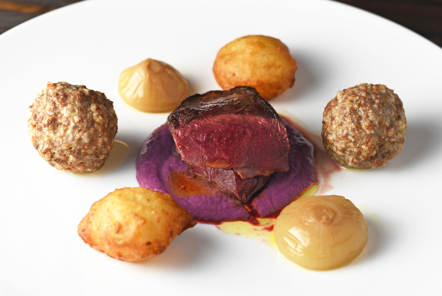Duck Breast And Meatballs, Potato Croquettes, Caramelized Onions. and Red Cabbage Purée