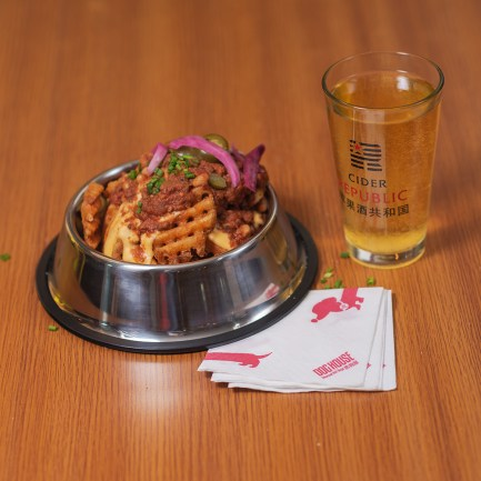 Waffle fries served with Cider at Dog house Shanghai