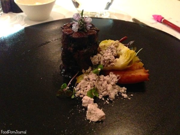 Oxtail with octopus, artichoke and black olive soil