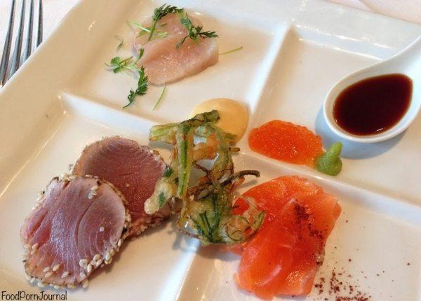 Sashimi plate of tuna tataki, salmon with salmon pearls, hiramasa kingfish with ponzu, crispy seaweed and wasabi mayonnaise