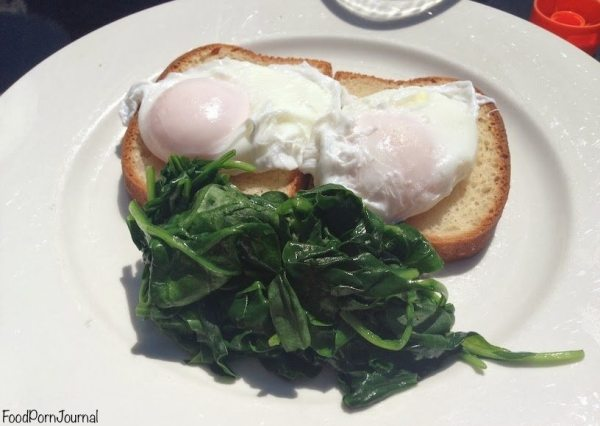 Poached eggs and spinach on gluten-free bread ($8.50)
