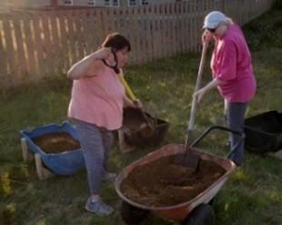 Elders and Women's group preparing raised-bed for planting