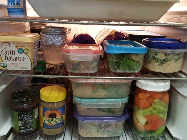 My tiny fridge filled with prepared meals! Behind those is fresh produce for salads.