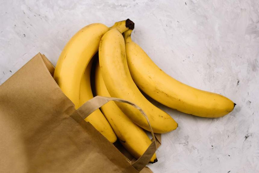 fresh bananas in paper bag