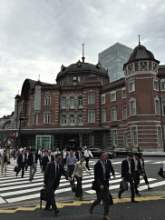 Office workers during the lunchtime rush outside Tokyo Station